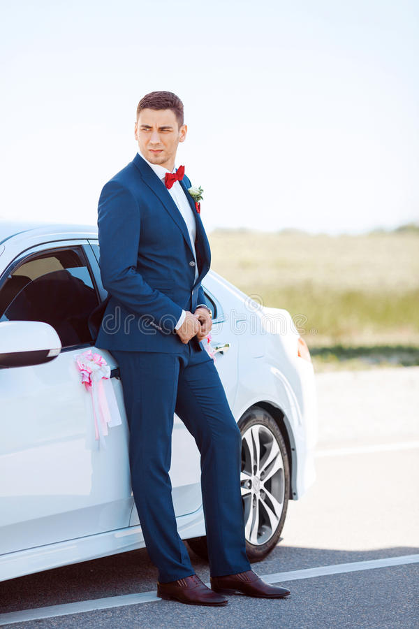 Serious Groom at the Car stock photo. Image of happy - 70257514