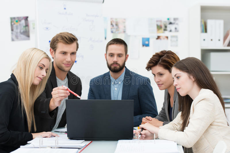 Serious group of business people in a meeting stock image