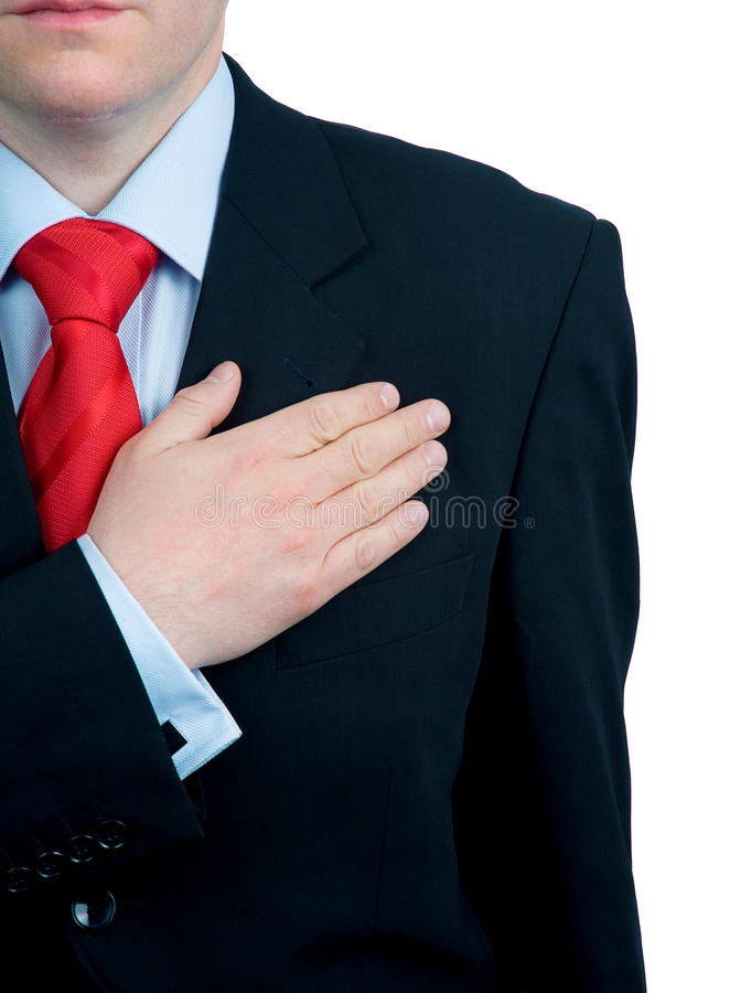 Serious hand on heart royalty free stock photos