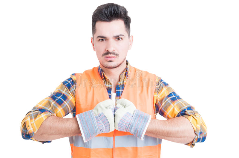 Serious handsome engineer looking ready for work. Showing fists with a determined attitude isolated on white background stock photo