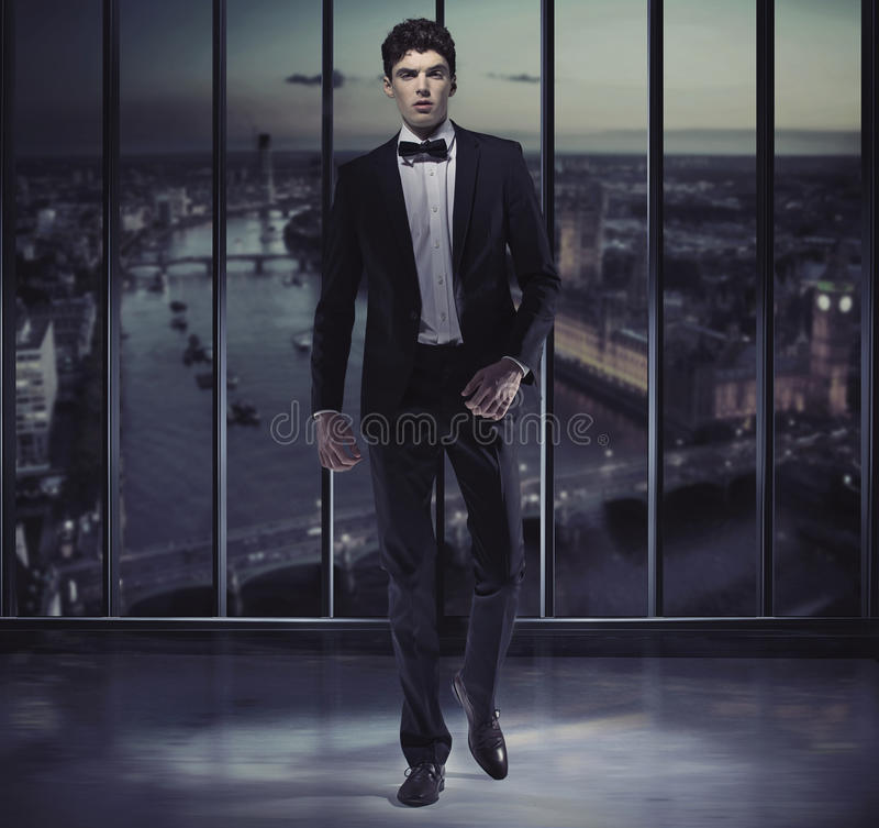 Serious Handsome Man On The Top Of The Skyscraper Stock Photo