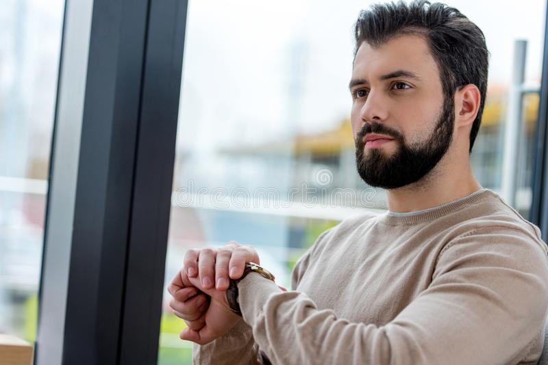 serious handsome man waiting for meeting royalty free stock photos