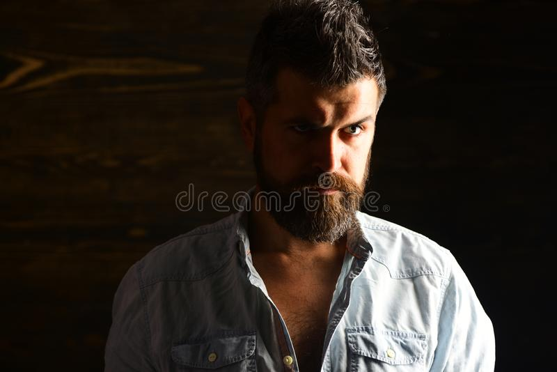 Serious hipster in barbershop, look. Barber and hairdresser salon. Haircut of bearded man, archaism. Fashion and male. Beauty of graying man. Man with beard and royalty free stock photography