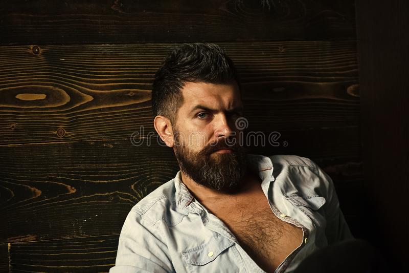 Serious hipster in barbershop, look. Haircut of bearded man, archaism. Fashion and male beauty of graying man. Barber. And hairdresser salon. Man with beard and royalty free stock photos