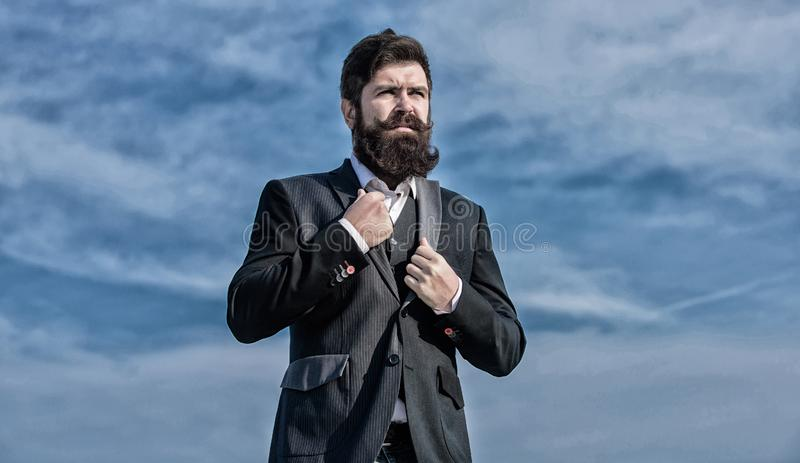 Serious hipster. Charismatic male. Businessman against the sky. brutal caucasian hipster with moustache. Mature hipster. With beard. Future success. Male formal royalty free stock images