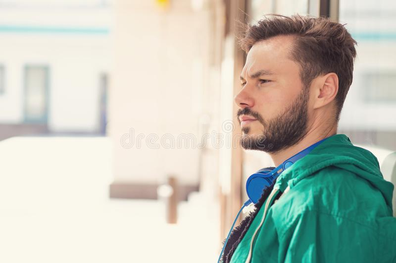 Serious hipster man looking away royalty free stock photography