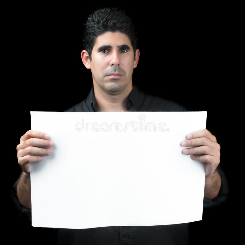 Serious hispanic man holding a white banner royalty free stock images