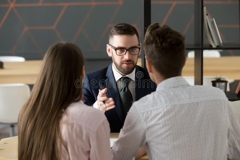 Serious investment broker, financial advisor or bank worker cons. Serious investment broker, financial advisor or bank worker in suit and glasses consulting royalty free stock photos
