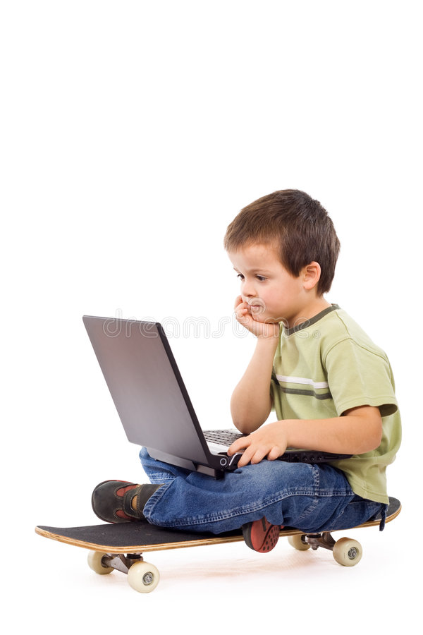Serious kid mobile computing. Kid on a skateboard with a laptop - isolated mobile computing concept stock photos