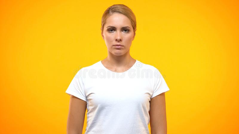 Serious lady looking camera, female rights, inner power, strength confidence royalty free stock photography