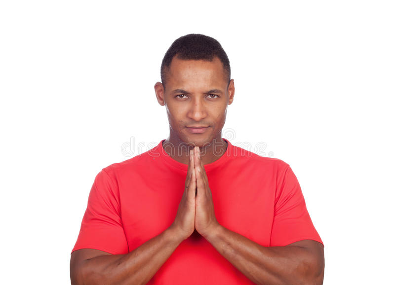 Serious latin men praying royalty free stock image