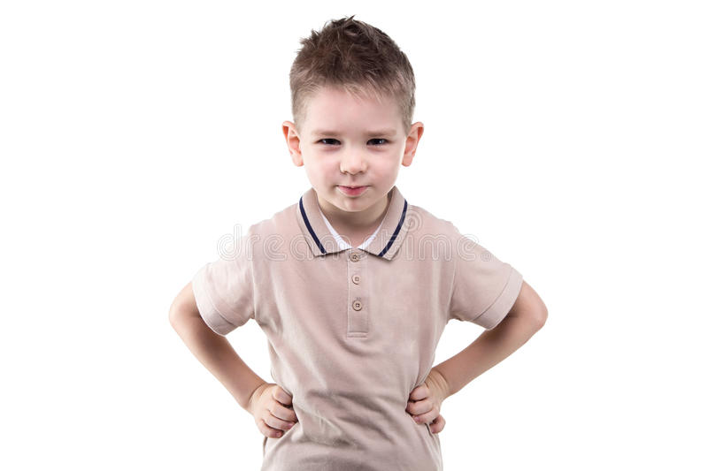 Serious little boy with hands on hips royalty free stock photography