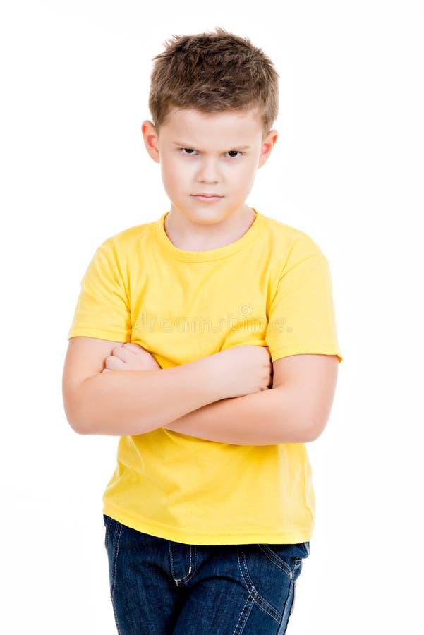 Serious little boy on stock photo