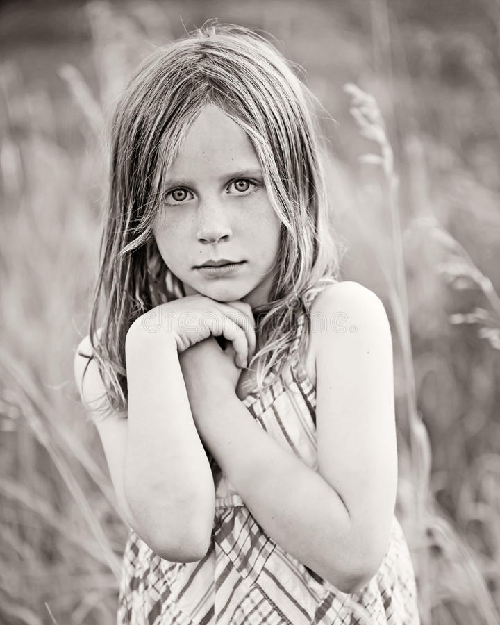 Serious Little Girl In Field Stock Image - Image Of Grass -2331