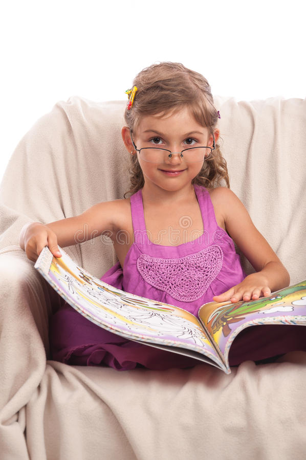 Download Serious Little Girl In Glasses With Big Book Stock Photo - Image: 25886406