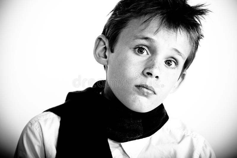 Serious looking boy stock photo