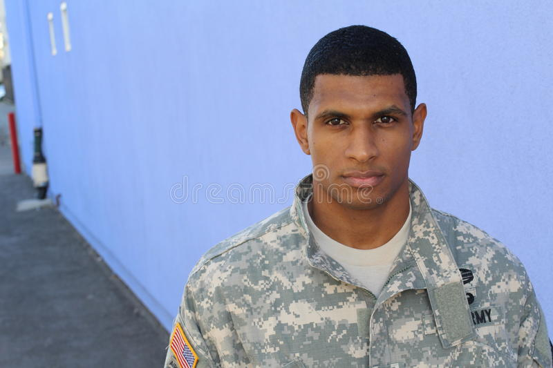 Serious looking serviceman with copy space on the left royalty free stock photography