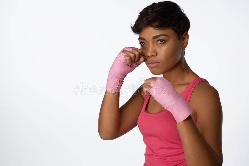 Serious looking woman fighting against breast cancer stock image