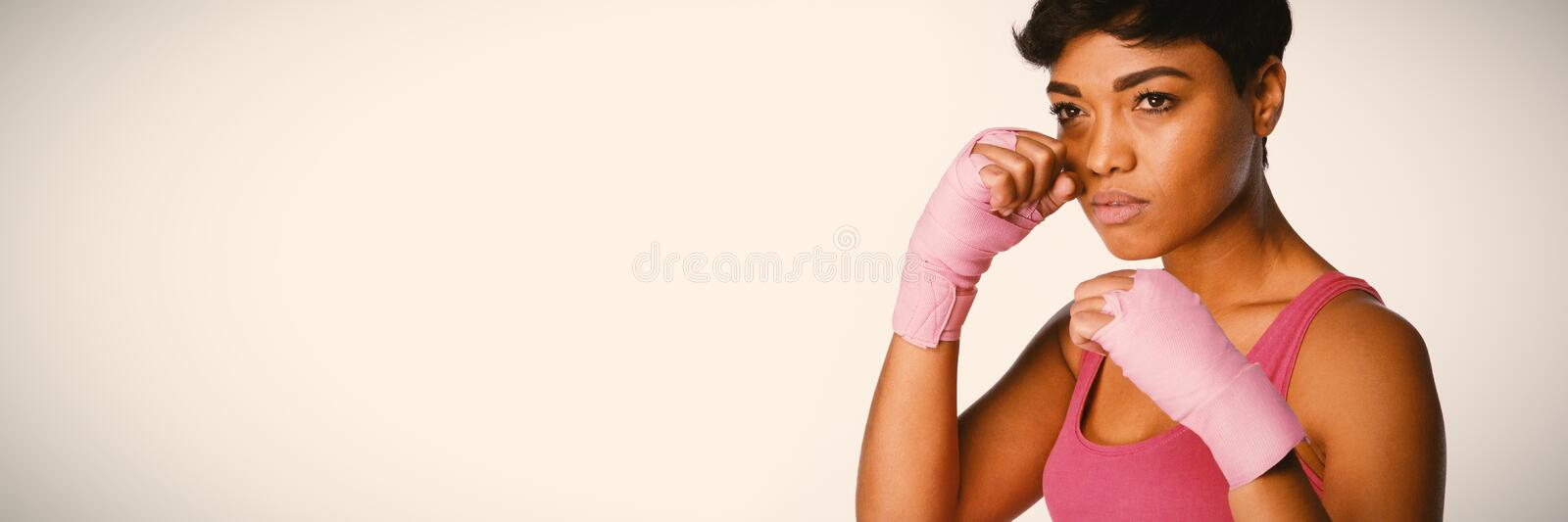 Serious looking woman fighting against breast cancer royalty free stock photo