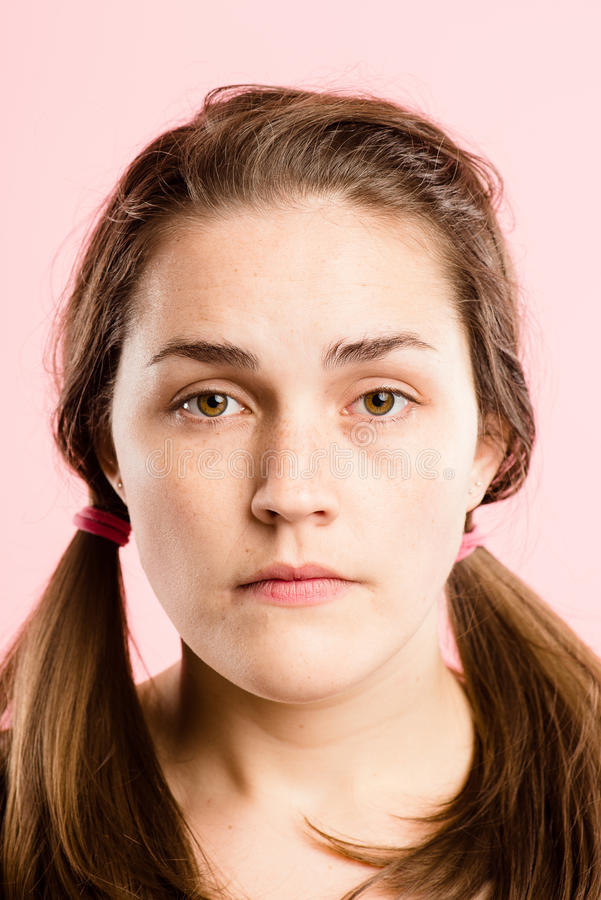 serious woman portrait pink background real people high definition stock photography