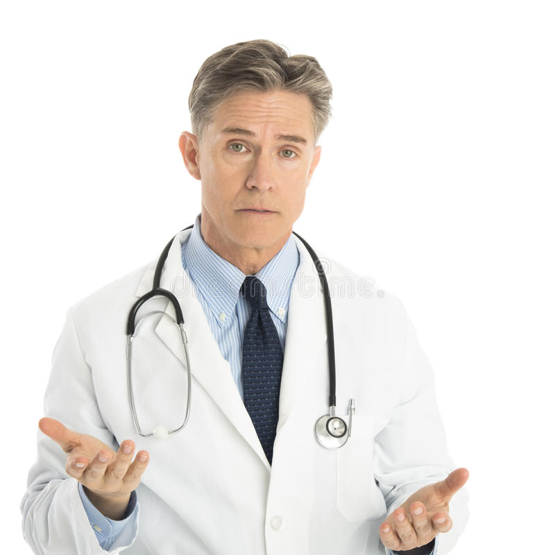 Serious Male Doctor Gesturing Against White Background