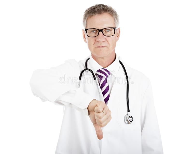Serious Male Doctor Giving Thumbs Down Sign stock images