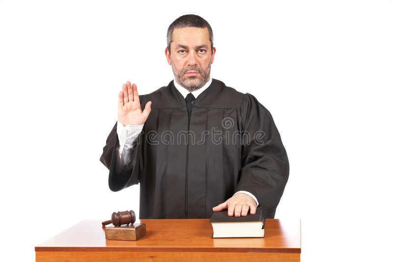 Serious male judge taking oath stock photography