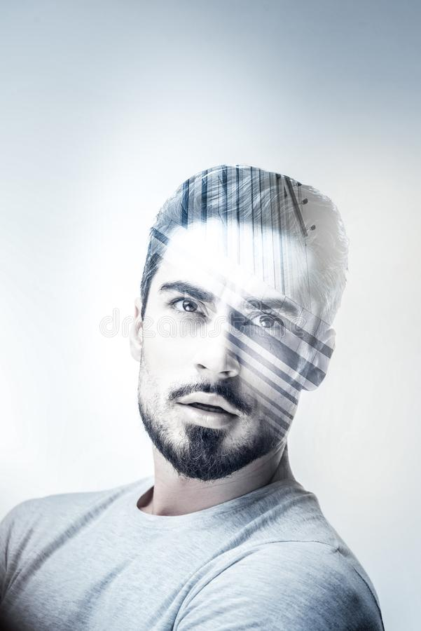 Serious male person having creative thoughts stock images