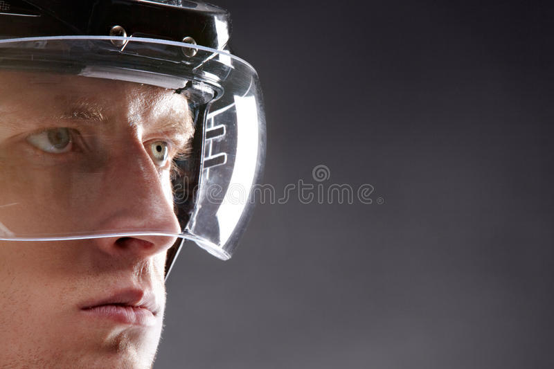 Serious man. Face of sportsman in protective helmet looking seriously forwards stock photo