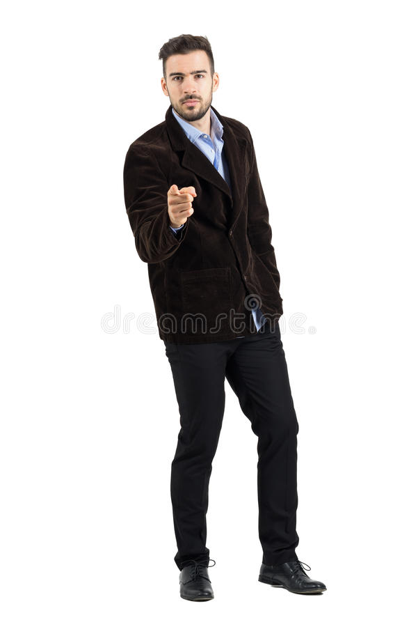 Serious man blame you while pointing finger at camera. Full body length portrait isolated over white studio background royalty free stock photography