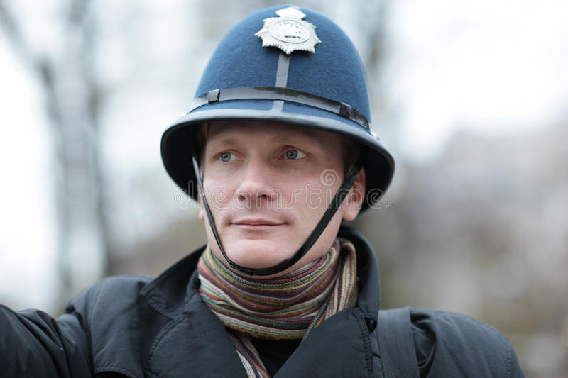 Download Serious Man In British Police Hat Stock Image - Image: 22182141