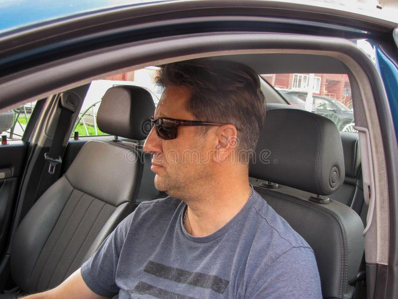Serious man in the car window royalty free stock photography