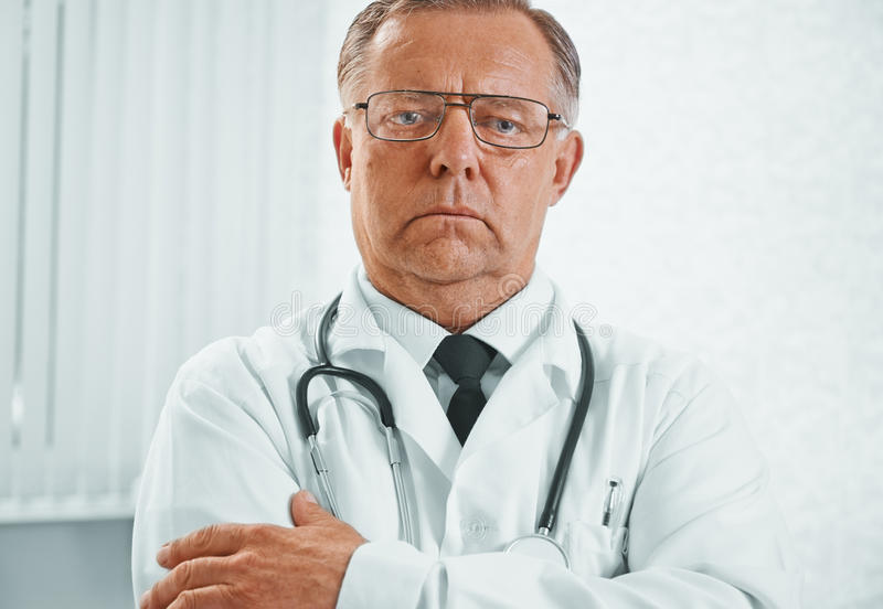 Serious man doctor royalty free stock photography
