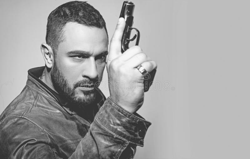 Serious man with gun ready to shoot. shot. concentrated on target. copy space. Hunting education. Gun in hand of shooter stock photography