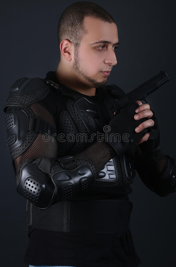 Serious man holding a Gun - Super cops stock photography
