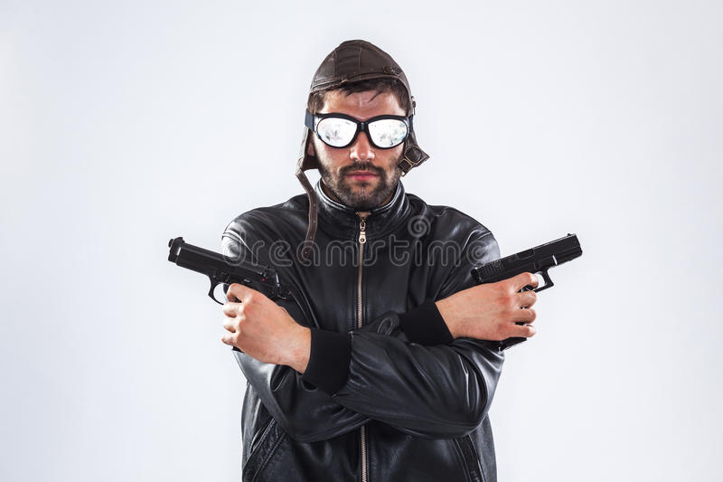 Serious man holding two guns in his hands royalty free stock images