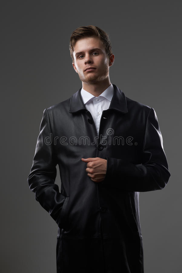 Serious man in a leather coat royalty free stock photo