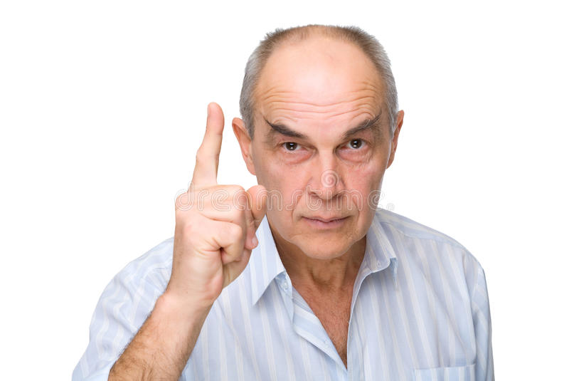 Serious man pointed his finger up stock photography