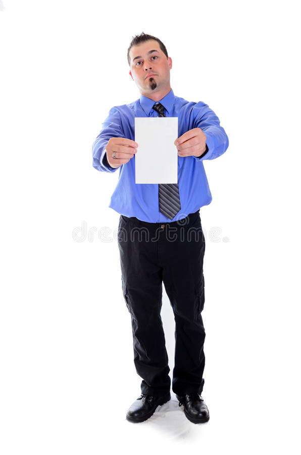 Serious man in shirt and tie holding blank card. A serious looking business man in blue shirt and tie holding a blank card stock photo