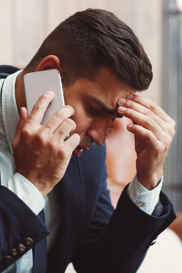 Serious man solving complex problems royalty free stock photo