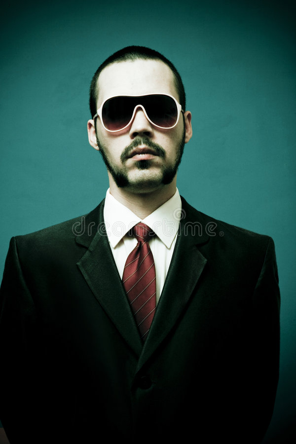 Serious man in suit, mobster stock photos