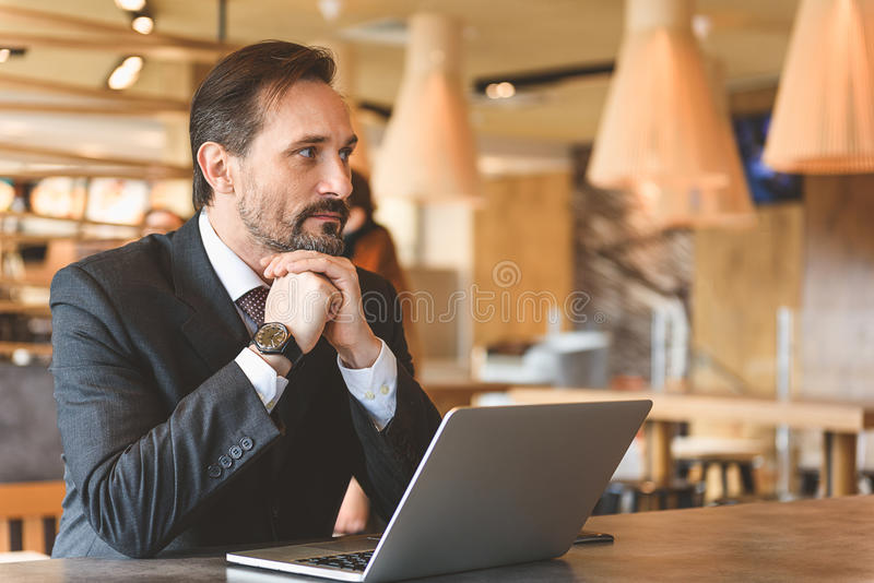 Serious man thinking about his business royalty free stock photos