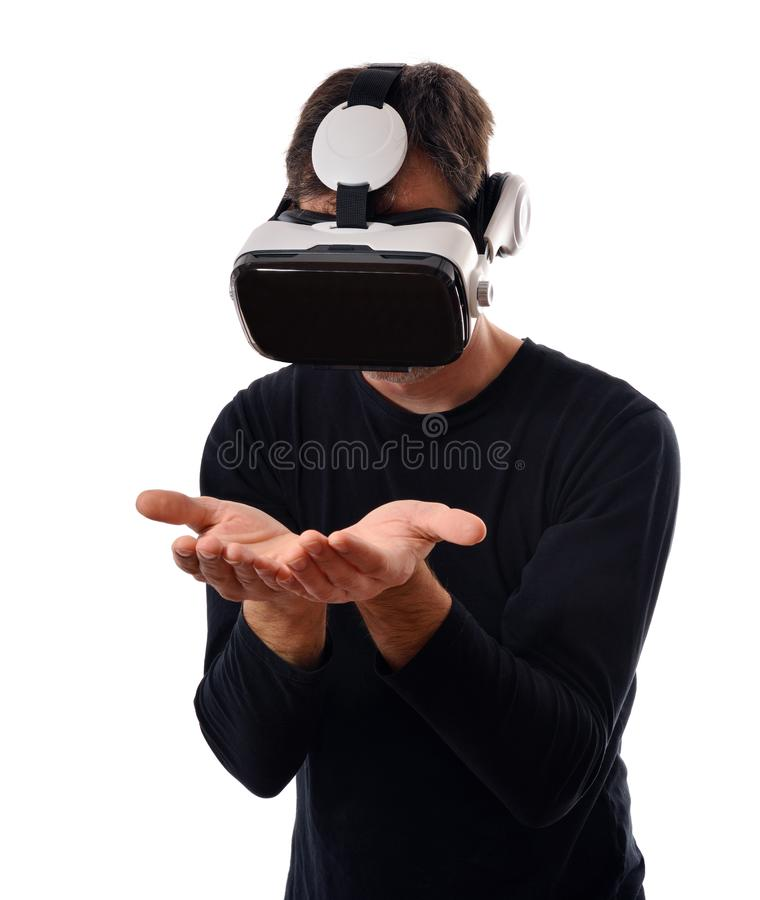 Serious man with vr glasses wanting to catch something stock photography
