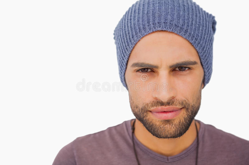 Serious man wearing beanie hat. On white background stock images