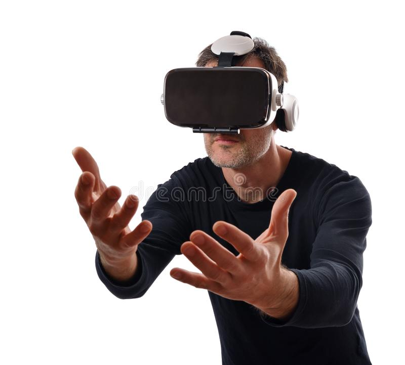 Serious man with vr glasses interacting with hands in front stock photo