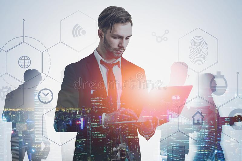 Serious manager with laptop, digital interface stock image