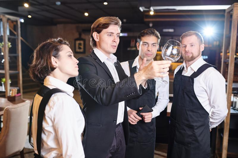 Serious manager working with waiters royalty free stock images