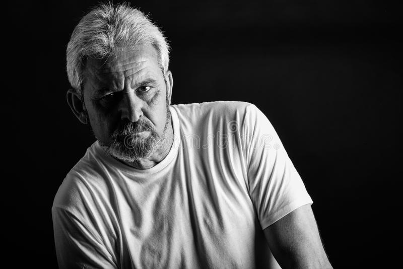 Serious mature man with white hair and beard stock photography