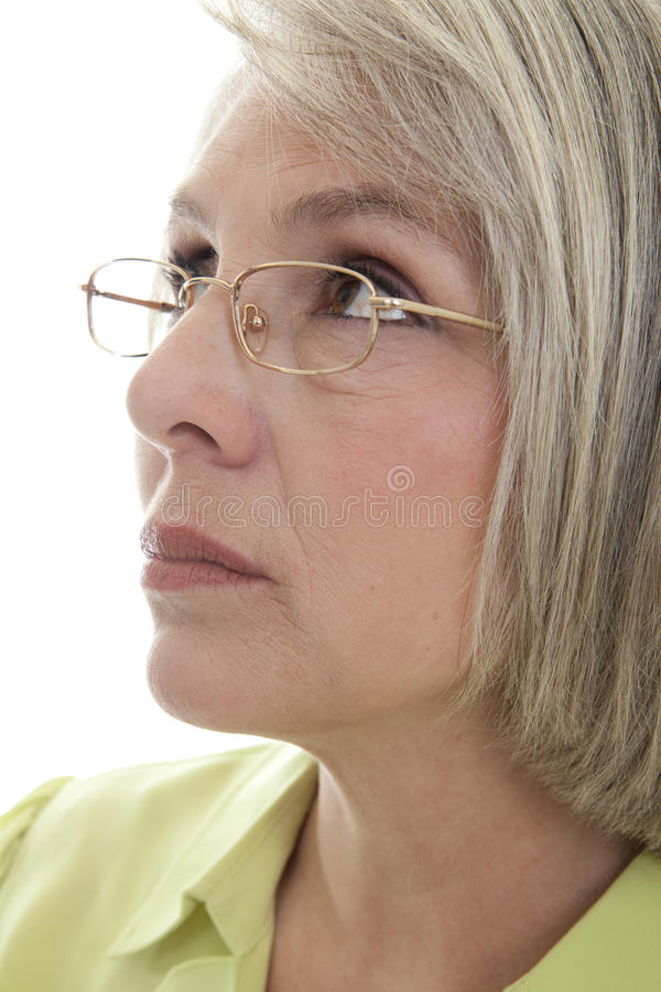Serious mature woman. Mature, attractive Caucasian woman looking off into the distance royalty free stock image