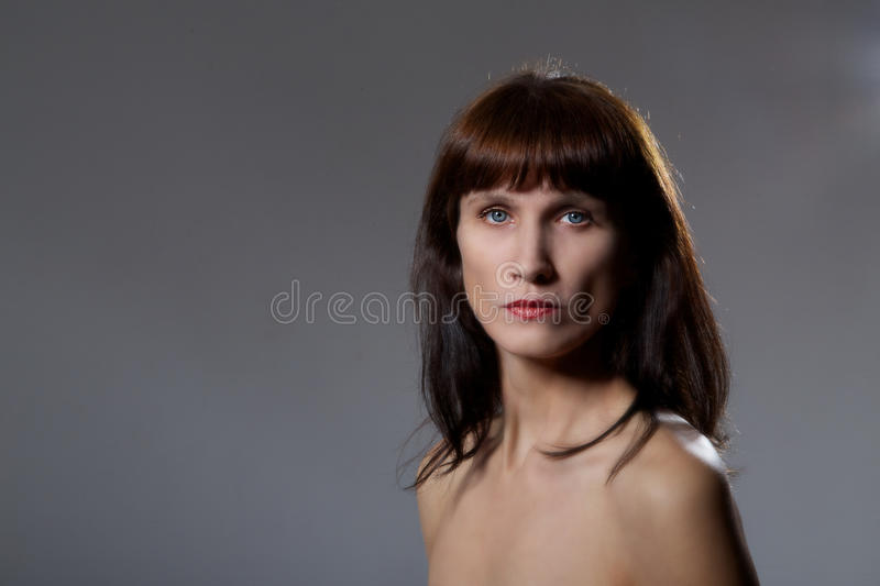 Serious mature woman royalty free stock photography